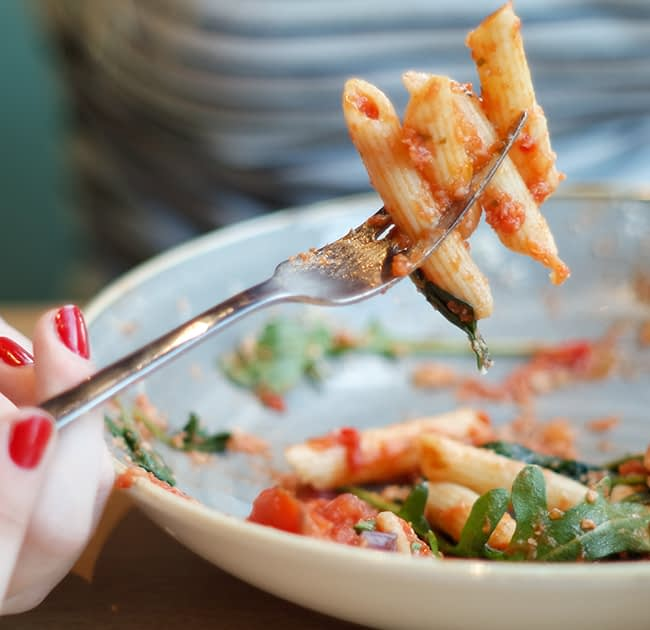 Bowl of penne pasta with marinara.