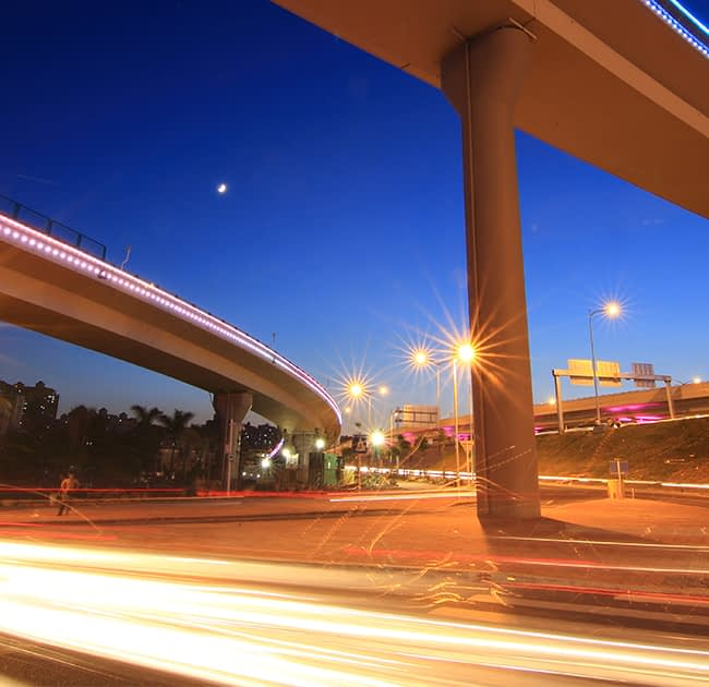 cars on freeway underpass at night