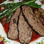 Pomegranate lime marinated grilled tri tip atop herb roasted potatoes served with lemon parmesan grilled asparagus.