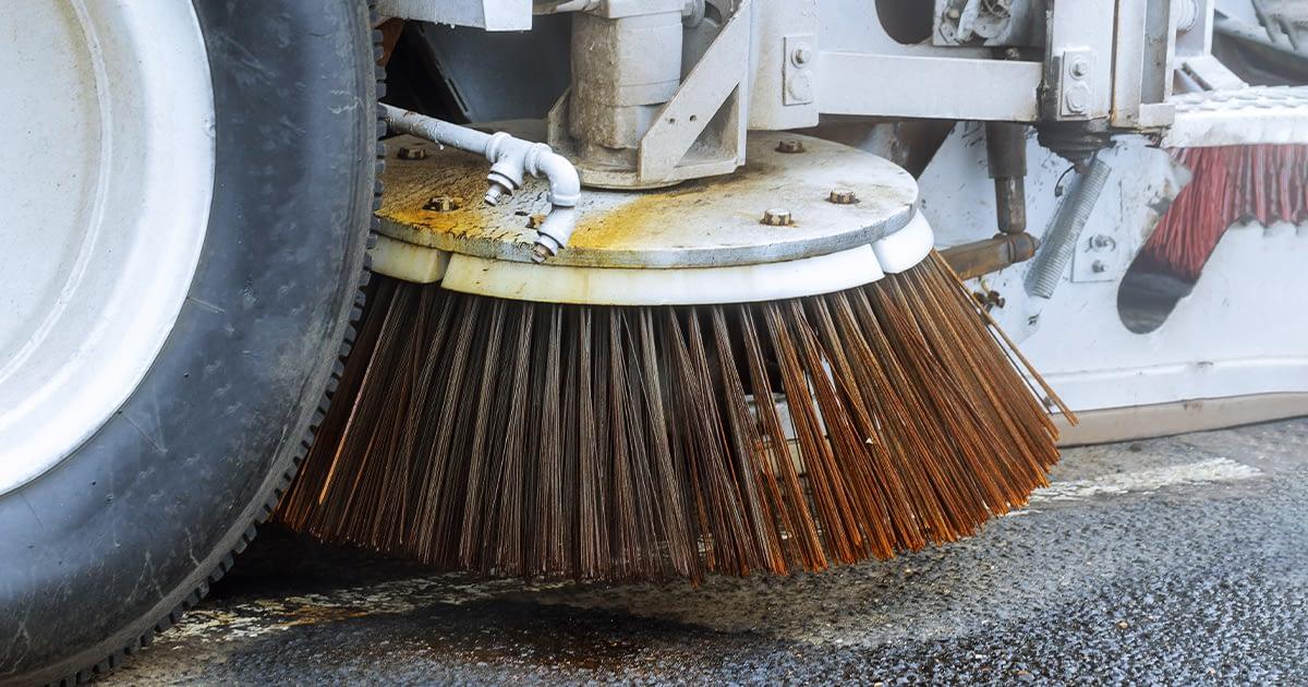close up of a street sweeper machine